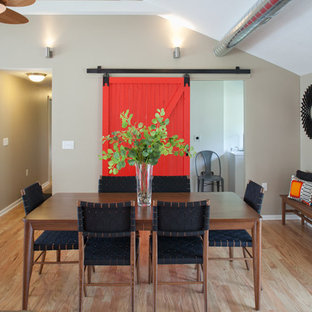 Red barn door with full view of dining table.