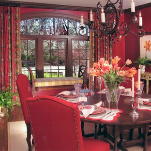 Inspiration for a mid-sized timeless medium tone wood floor kitchen/dining room combo remodel in Columbus with red walls and no fireplace