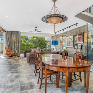 Design ideas for an asian open plan dining in Perth with white walls and grey floor.