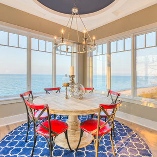 Example of a small beach style light wood floor kitchen/dining room combo design in Chicago with beige walls