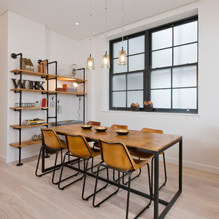 Photo of a scandinavian dining room in Dorset with white walls and light hardwood flooring.