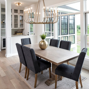 Dining room - transitional light wood floor and beige floor dining room idea in Minneapolis with white walls