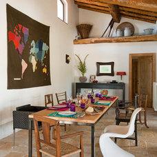 Rustic Dining Room by Claudia Pelizzari Interior Design