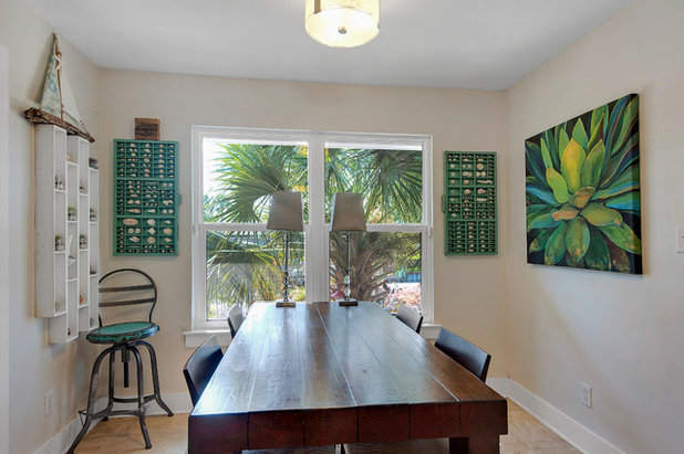 Tropical Dining Room by Omega Construction & Design