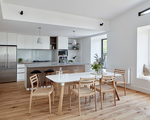 This Is An Example Of A Contemporary Kitchen/dining Combo In Melbourne With  White Walls