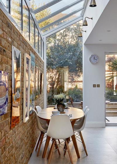 Transitional Dining Room by Hampstead Design Hub