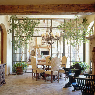 Inspiration for a mediterranean dining room in San Diego with beige walls and beige floors.
