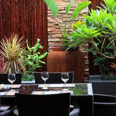 Tropical Dining Room by Fuse Landscape Design