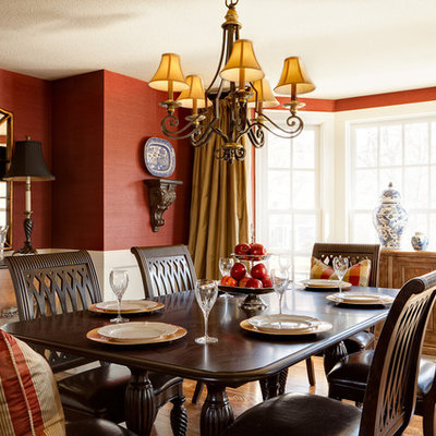 Dining room - traditional medium tone wood floor dining room idea in Boise with red walls