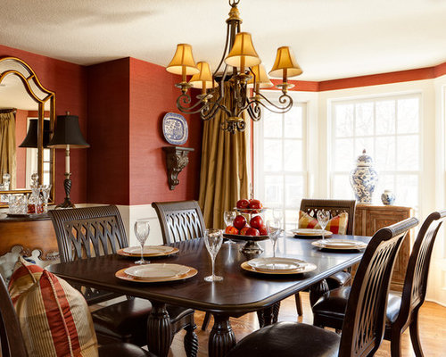 Traditional Medium Tone Wood Floor Dining Room Idea In Kansas City With Red Walls