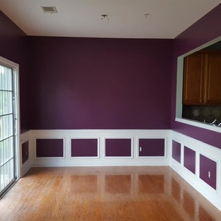 Enclosed dining room - mid-sized traditional medium tone wood floor and brown floor enclosed dining room idea in San Diego with purple walls and no fireplace