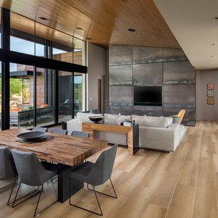 Example of a trendy light wood floor and beige floor great room design in Phoenix
