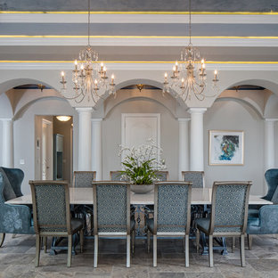 Example of a tuscan gray floor dining room design in Orlando with gray walls