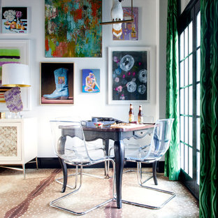 Eclectic open plan dining room in Charlotte with white walls and carpet.