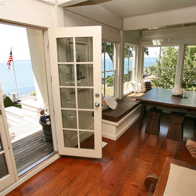Example of a mid-sized beach style dark wood floor great room design in Seattle with white walls