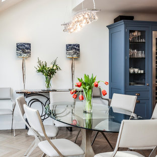 Medium sized contemporary dining room in London with white walls, light hardwood flooring and beige floors.