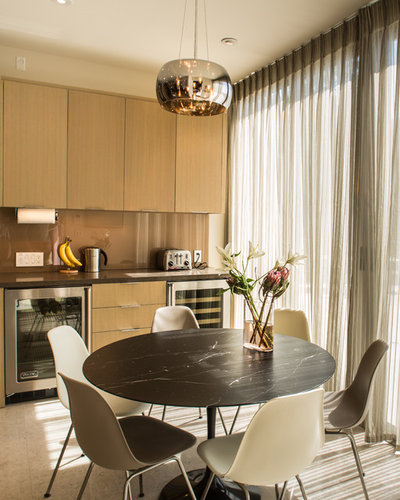 Contemporary Dining Room by Tuggey Construction
