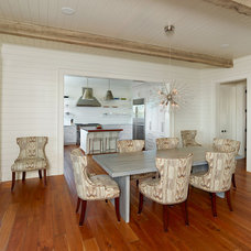 Beach Style Dining Room by Bill Huey + Associates