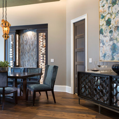 Enclosed dining room - mid-sized contemporary medium tone wood floor enclosed dining room idea in Jacksonville with gray walls and no fireplace