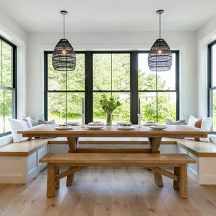 Dining room - small cottage light wood floor and beige floor dining room idea in Portland Maine with gray walls and no fireplace