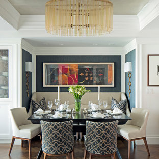 Small traditional dining room in New York with dark hardwood flooring and brown floors.