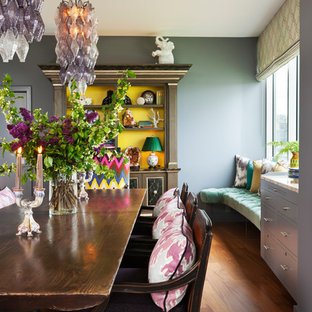 Example of a huge eclectic medium tone wood floor dining room design in Portland with gray walls