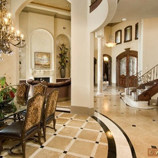 Mediterranean Dining Room by Gary Keith Jackson Design Inc
