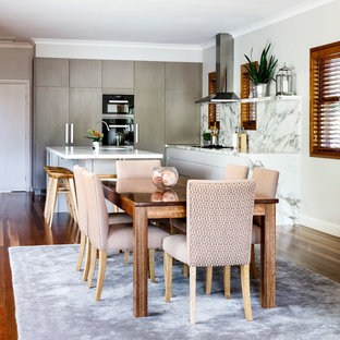 Large transitional open plan dining in Sydney with medium hardwood floors and multi-coloured floor.