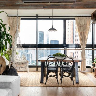Urban medium tone wood floor and brown floor great room photo in Hong Kong