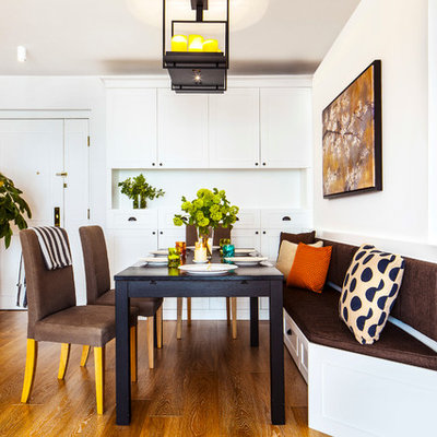 Transitional medium tone wood floor dining room photo in Hong Kong with white walls