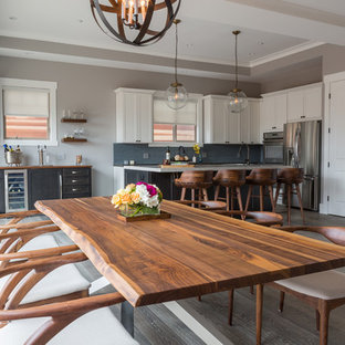 Photo of a mid-sized transitional open plan dining in Los Angeles with dark hardwood floors and grey walls.