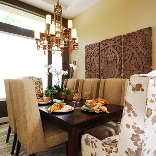 Dining room - transitional carpeted dining room idea in San Diego with yellow walls
