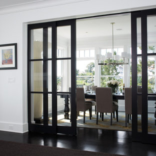 Enclosed dining room - transitional black floor enclosed dining room idea in Boston with white walls