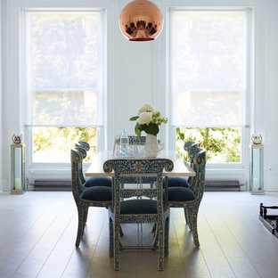 Country dining room photo in Other with beige walls