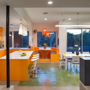 Example of a trendy ceramic floor and green floor kitchen/dining room combo design in Austin with white walls