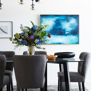 This is an example of a contemporary dining room in Brisbane.