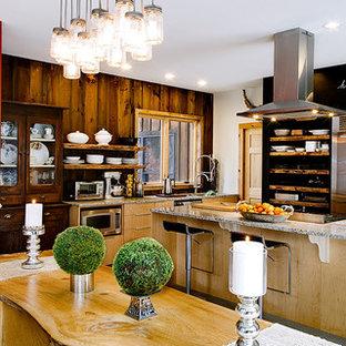 Diseño de comedor de cocina rural, de tamaño medio, con paredes rojas, suelo de cemento, chimeneas suspendidas y suelo gris
