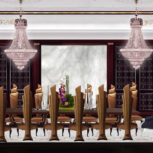 Ejemplo de comedor de estilo americano, extra grande, abierto, con paredes negras, suelo de mármol, chimenea de doble cara y marco de chimenea de piedra