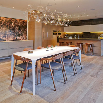 Large trendy light wood floor kitchen/dining room combo photo in Vancouver with white walls and no fireplace