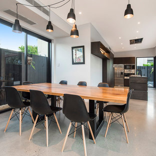 Inspiration for a contemporary separate dining room in Perth with grey walls, concrete floors and grey floor.