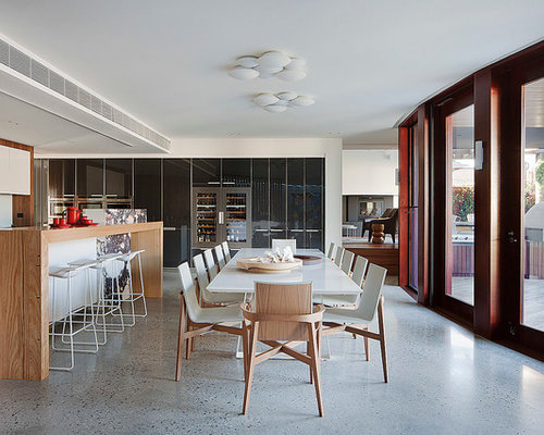 Example Of A Large Trendy Concrete Floor Kitchen/dining Room Combo Design  In Melbourne With