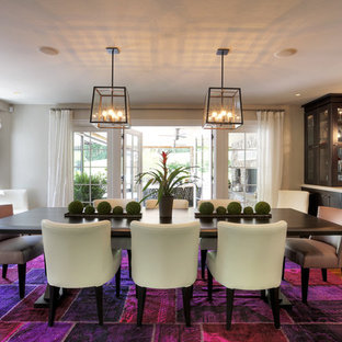 Inspiration for a mid-sized contemporary medium tone wood floor kitchen/dining room combo remodel in New York with beige walls