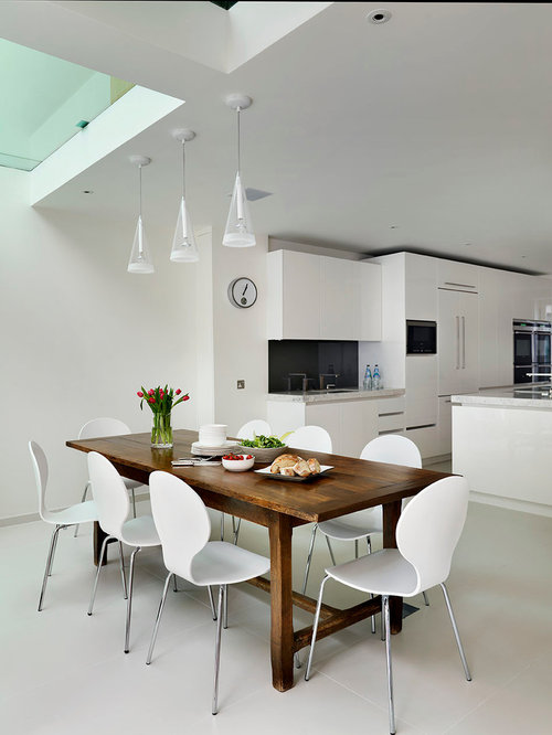 Large Trendy Kitchen/dining Room Combo Photo In London With White Walls
