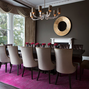 Large modern enclosed dining room in London with brown walls, dark hardwood flooring, a wood burning stove, a stone fireplace surround and brown floors.