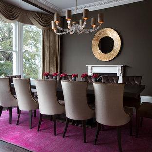 Ispirazione per una grande sala da pranzo moderna chiusa con pareti marroni, parquet scuro, stufa a legna, cornice del camino in pietra e pavimento marrone