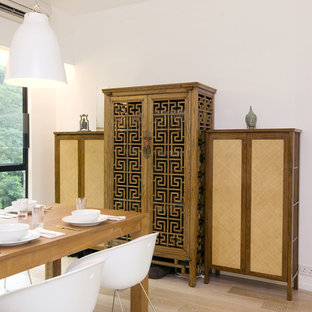 Inspiration for a contemporary medium tone wood floor dining room remodel in Hong Kong with white walls