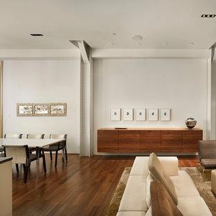Example of a minimalist dark wood floor great room design in Philadelphia with white walls
