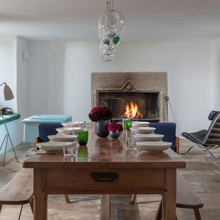 Farmhouse Enclosed Dining Room In Cornwall With White Walls A Standard Fireplace Stone