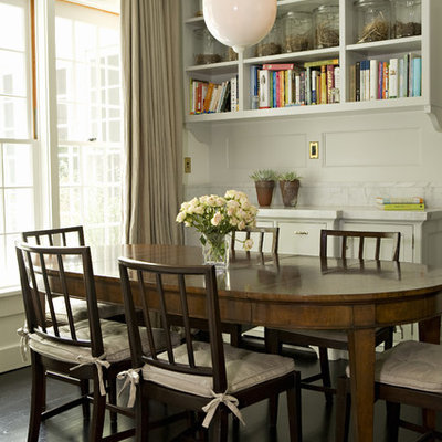 Example of a transitional dark wood floor dining room design in Los Angeles with white walls