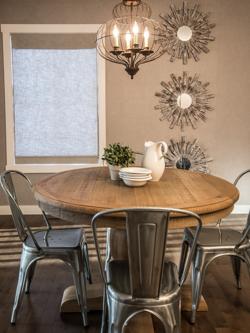 Inspiration for a rustic dark wood floor dining room remodel in Calgary  with beige walls